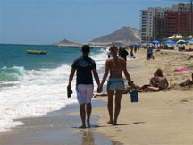 Couple walking on the beach in Rocky Point, Mexico